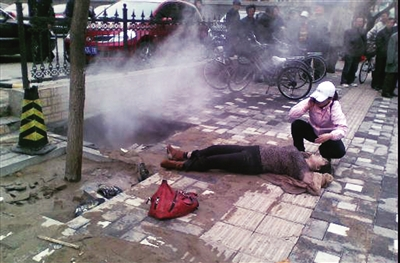 Beijing, april 2012. The woman was just walking over the sidewalk back to work from her lunchbreak. The sinkhole was caused by a leaking hot water pipe. She was boiled to death. Literally.